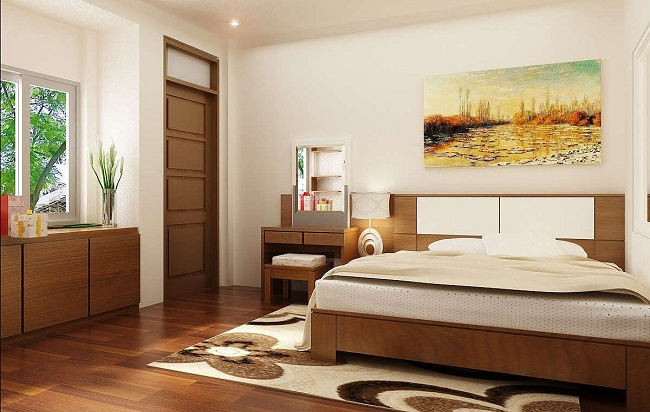 Giường ngủ đối diện với cửa phòng